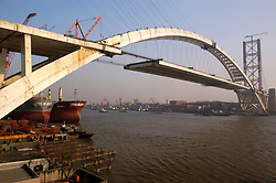 Construction of Lupu Bridge in Shanghai the world`s longest steel arch bridge