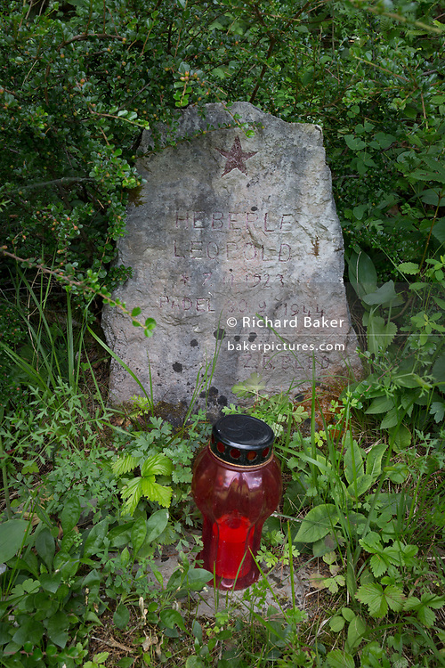 The grave of a Partisan fighter, killed during WW2 in 1944, on 18th June 2018, in Kupljenik, Slovenia