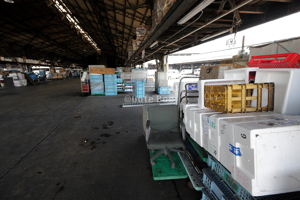 end of work day, after hours, sorting and distribution area at Tsukiji Wholesale Fish Market,  Tokyo, Japan.