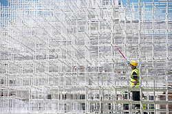 Kensington Gardens.<br /> A workman putting the final touches of paint to the The Serpentine Gallery Pavilion 2013, it will open on 8 June and is designed by multi award-winning Japanese architect Sou Fujimoto, London, UK,<br /> Monday 3rd, June 2013<br /> Picture by i-Images