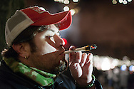 December 6, 2012. Seattle, Washington. Washington and Colorado became the first states to vote to decriminalize and regulate the possession of an ounce or less of marijuana by adults over 21. Pictured at a 'Stash Mob' gathering in Seattle is Darin Ellis, smoking marijuana in public...Photo © John Chapple / www.JohnChapple.com