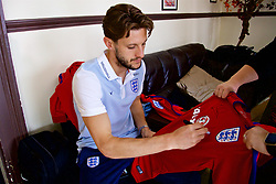 LIVERPOOL, ENGLAND - Wednesday, May 17, 2017: Liverpool and England's Adam Lallana signs an England shirt during a photoshoot for Vauxhall at the Devonshire House Hotel. (Pic by David Rawcliffe/Propaganda)