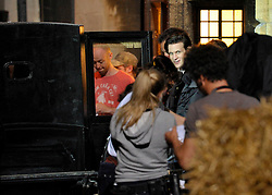 © Licensed to London News Pictures. 20/08/2012. Bristol, UK. Actor Matt Smith on set as the BBC's Dr Who film around Corn Street in Bristol's old city centre.  Fake snow was used for a winter scene with Matt Smith as Doctor Who dressed in a top hat, doing a scene with a horse drawn carriage and the new doctor's companion Jenna-Louise Coleman.  20 August 2012..Photo credit : Simon Chapman/LNP