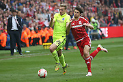 Brighton striker (on loan from Manchester United), James Wilson (21)  fighs it out with Middlesbrough defender George Friend (3)  during the Sky Bet Championship match between Middlesbrough and Brighton and Hove Albion at the Riverside Stadium, Middlesbrough, England on 7 May 2016. Photo by Simon Davies.