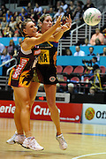 Jessica Tuki and Clare McNeniman compete for the ball during action from the Major Semi Final of the ANZ Netball Championship played between the Firebirds and the Magic at the Gold Coast Convention and Exhibition Centre on Monday 9th May 2011