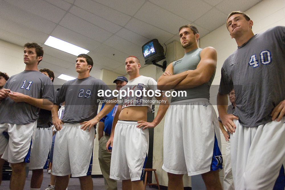 28 May 2007: Duke Blue Devils midfielder Fred Krom (11), midfielder Mike Catalino (29), attackman Zack Greer (25), midfielder Bo Carrington (31) and attackman Matt Danowski (40) in a pregame meeting in the locker room before playing Johns Hopkins in the NCAA Championship at M&T Stadium in Baltimore, MD.