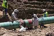 Welders working on the Bayou Bridge Pipeline in Crowley Louisiana.