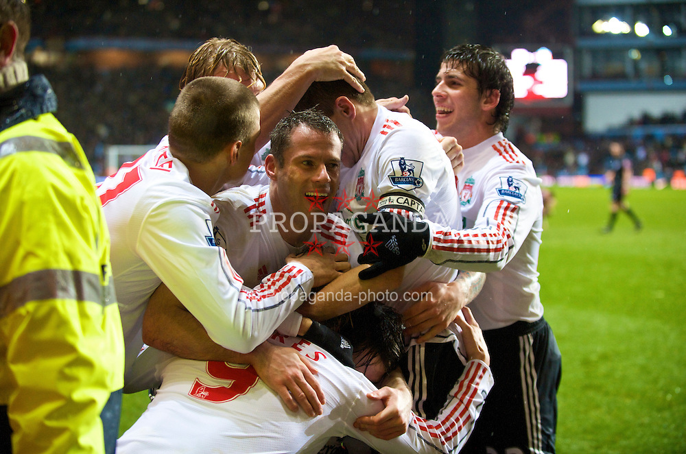 BIRMINGHAM, ENGLAND - Tuesday, December 29, 2009: Liverpool's Fernando Torres celebrates scoring his 50th Premier League goal for the club with team-mates Martin Skrtel, Dirk Kuyt, Jamie Carragher, captain Steven Gerrard MBE and Emiliano Insua breaking the club record of 50 goals in the least appearances, during the Premiership match against Aston Villa at Villa Park. (Photo by: David Rawcliffe/Propaganda)