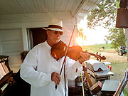 Paul Sebesta playing fiddle on the porch