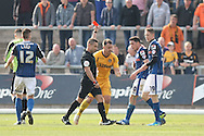Referee James Adcock shows the red card to Aaron O'Connor (out of picture). Skybet football league two match, Newport county v Rochdale at Rodney Parade in Newport, South Wales on Saturday 3rd May 2014.<br /> pic by Mark Hawkins, Andrew Orchard sports photography.