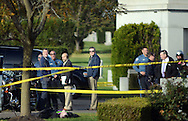 EDITORS NOTE: GRAPHIC CONTENT OF BODY IN FOREGROUND: Police personnel investigate the scene of a shooting Wednesday October 26, 2016 at Roosevelt Memorial Park in Bensalem, Pennsylvania. (Photo by William Thomas Cain)
