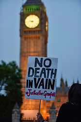 "© Licensed to London News Pictures. 19/06/2017. London, UK.  A banner which reads ""No Death In Vain"" is held aloft during a vigil in Parliament Square to remember those who died in the Grenfell Tower fire in North Kensington of 14 June.  Mourners and wellwishers were given the opportunity to speak and to write messages on a community banner.  Photo credit : Stephen Chung/LNP"
