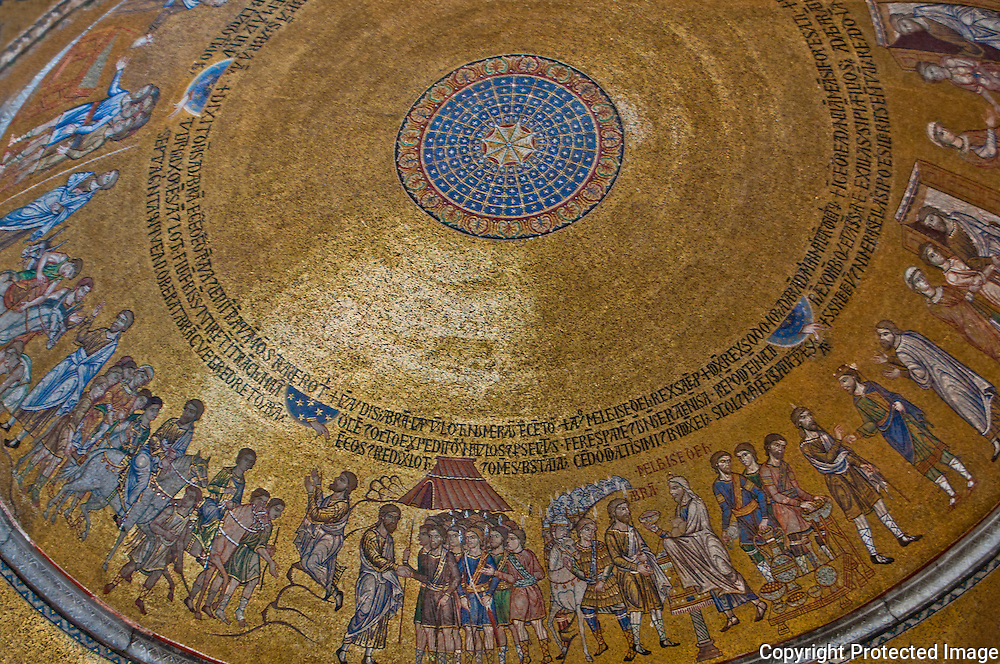 Close-up of a magnificent gold tile mosaic dome ceiling in St. Mark's Basilica in Venice, Italy.