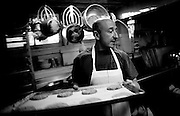 Tony Nuovo works at his family's bakery Layers on Monday, January 28, 2007.