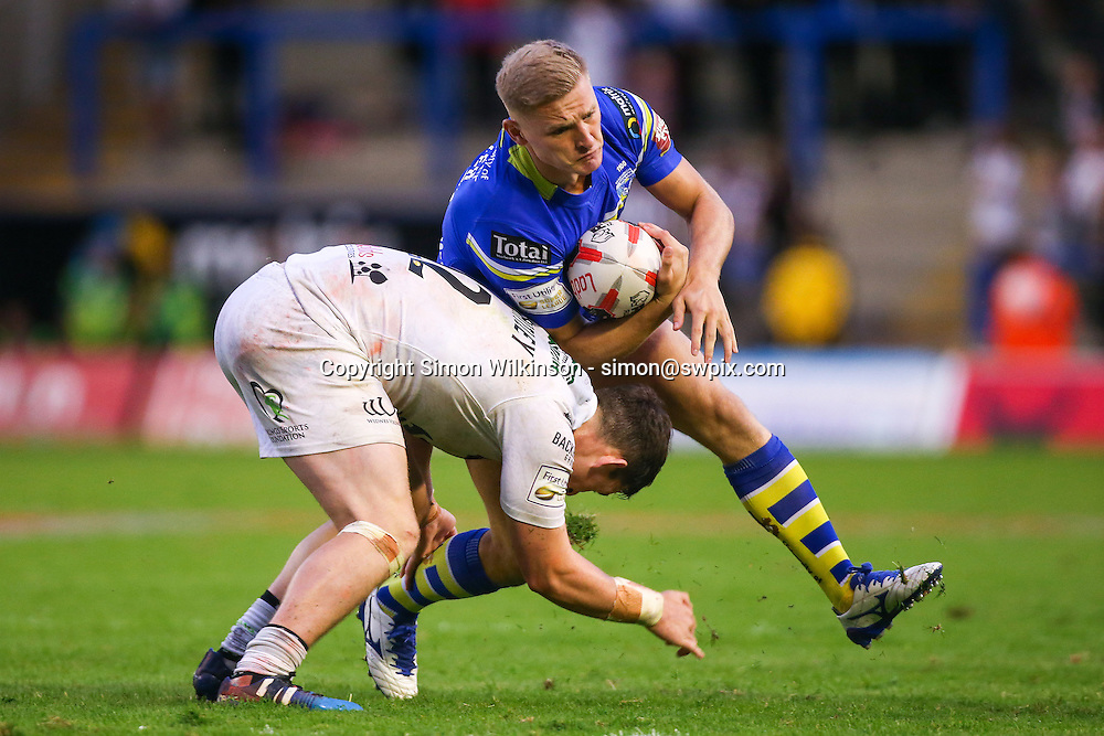 Picture by Alex Whitehead/SWpix.com - 24/06/2016 - Rugby League - Ladbrokes Challenge Cup - Warrington Wolves v Widnes Vikings - Halliwell Jones Stadium, Warrington, England - Warrington's Brad Dwyer is tackled by Widnes' Matt Whitley.