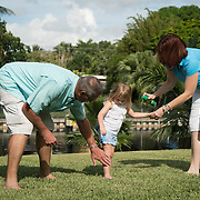 SEPTEMBER 10, 2016----WEST PALM BEACH, FLORIDA<br /> Brenda Hockman, 41 and husband Sean, 44, spray daughter Skylar Hockman, 2,  with insect repellent while in their house's backyard on a Saturday morning.<br /> (Photo by Angel Valentin/Freelance Photographer)