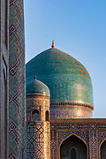 """Tilla-Kori Madrasah, at the heart of the Registan, Samarkand. Completed in around 1660 the name """"Tilla-Kori"""" is translated as """"decorated with gold"""". Here in the soft morning light (around 06.00) warming the intricate mosaic tiles."""