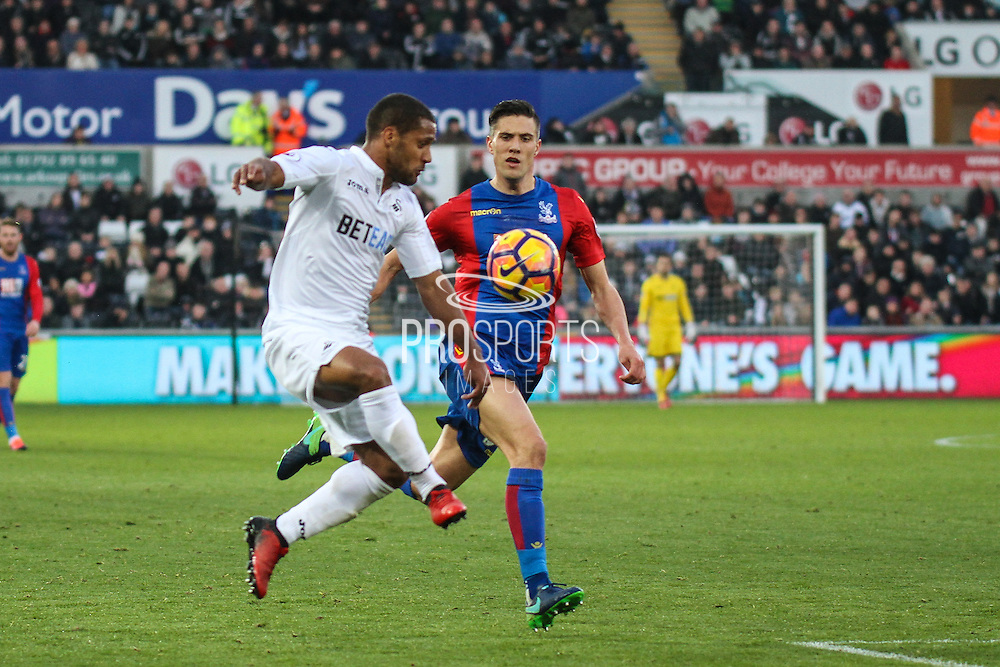 Wayne Routledge of Swansea City and Martin Kelly of Crystal Palace during the Premier League match between Swansea City and Crystal Palace at the Liberty Stadium, Swansea, Wales on 26 November 2016. Photo by Andrew Lewis.