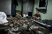 16th BC French unit soldier has rest in his room on September 23, 2012  in Warehouse base in Kabul. The French unit from Bitche (Moselle) will spend a week disassembling weapons, cleanning tanks and preparing their departure for France. AFP PHOTO / JEFF PACHOUD