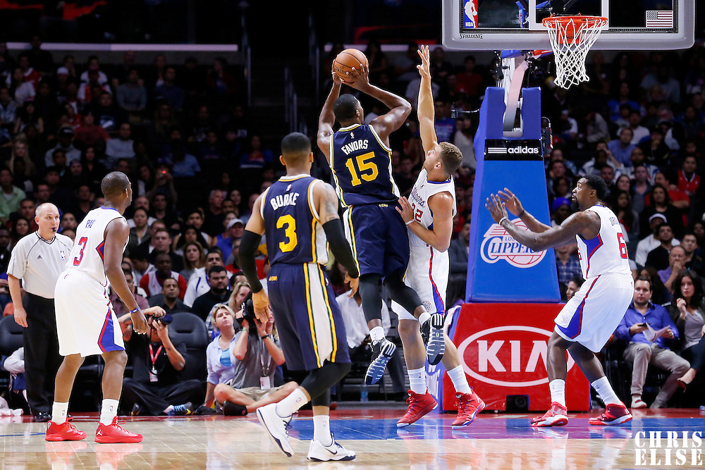 17 October 2014: Utah Jazz center Derrick Favors (15) takes a jump shot over Los Angeles Clippers forward Blake Griffin (32) during the Los Angeles Clippers 101-97 victory over the Utah Jazz, in a preseason game, at the Staples Center, Los Angeles, California, USA.