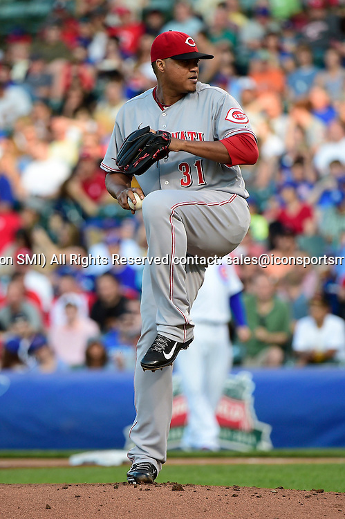 23 June 2014: Cincinnati Reds starting pitcher Alfredo Simon (31) pitching in a MLB game between the Chicago Cubs and the Cincinnati Reds at Wrigley Field, Chicago, Il