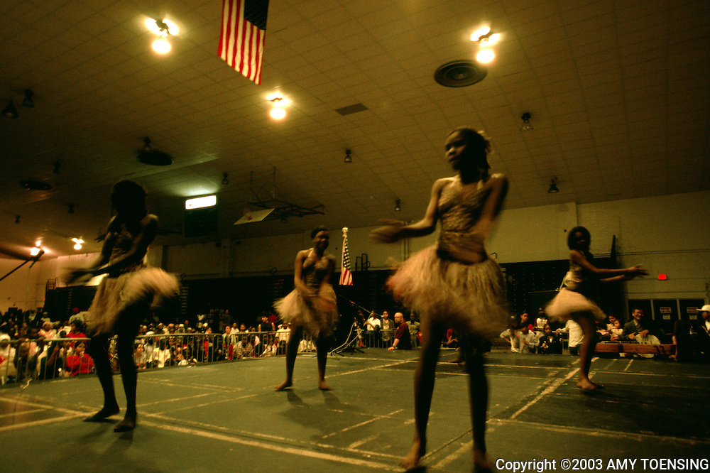 PORTLAND, ME- MAY 01: The Nile Girls, a traditional Sudanese dance troupe, perform at a multicultural potluck May 1, 2003 in Portland, Maine. The group is made up of Sudanese high school students who have left the turmoil in Sudan and have settled in Maine. (Photo by Amy Toensing). _________________________________<br />