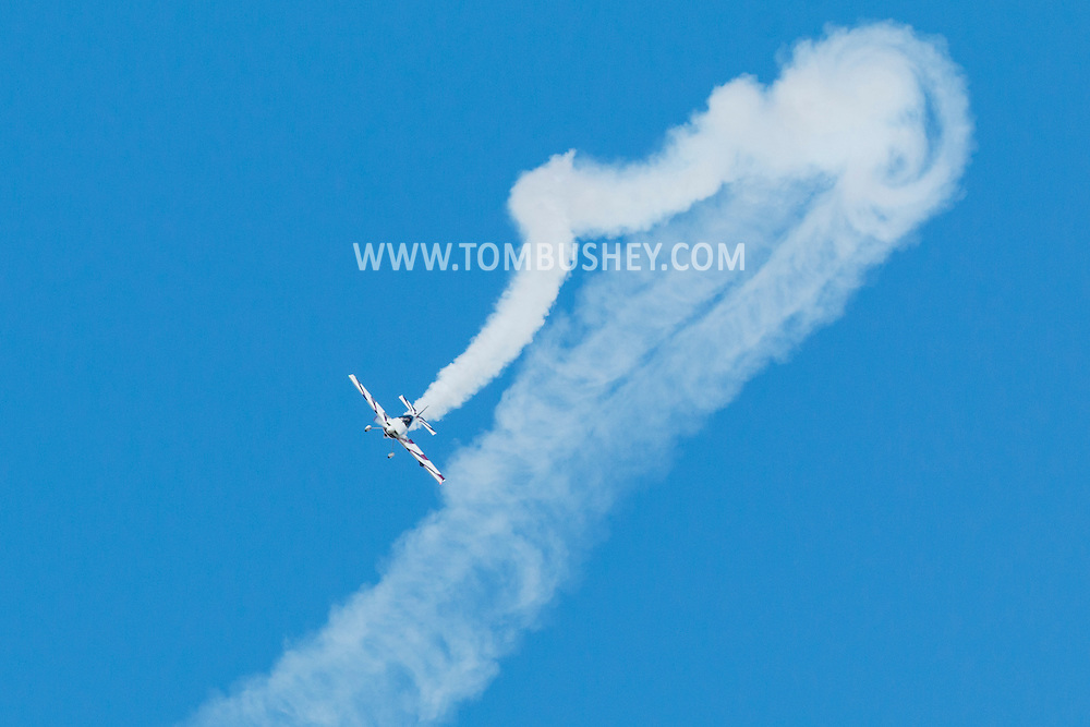New Windsor, New York - Andrew Wright of Austin, Texas, flies his stunt plane during practice for the New York Air Show at Stewart International Airport on Aug. 28, 2015. A few minutes later, the tail broke off the plane, which crashed and killed Wright. He was the only one on the plane. The smoke coming from the plane is part of the show.