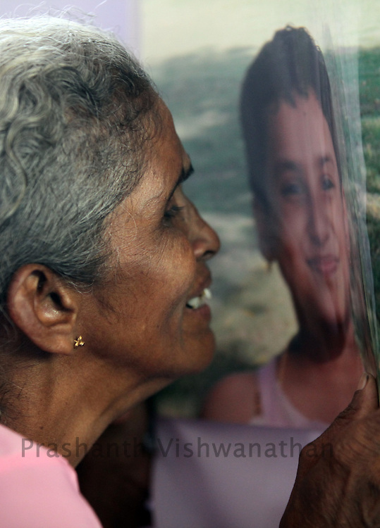The grand mother of an Air India Express crash victim mourns over the photograph on the coffin of her granddaughter H. Goldine during funeral service  at the St. Alphonsa Catholic Church, on May 23, 2010 in Mangalore. H.Rosaline and her two daughters H.Goldine and H.Gloria were passengers of the Air India Express Boeing 737-800 series aircraft arriving from Dubai, with 166 people onboard. Th flight overshot the runway on landing in Mangalore and crashed into a forest. Airline officials say 8 survivors have been rescued with 158 others feared dead. (Photo by Prashanth Vishwanathan/Getty Images)