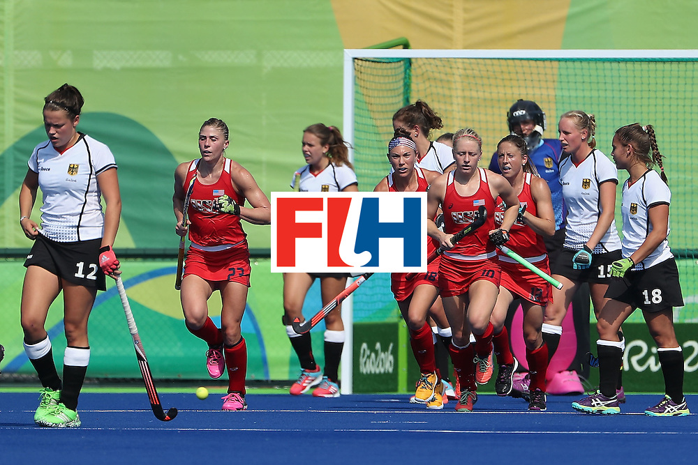 RIO DE JANEIRO, BRAZIL - AUGUST 15:  (second from left) Katelyn Falgowski #23 of United States reacts after scoring against Germany during the second half of the quarter final hockey game on Day 10 of the Rio 2016 Olympic Games at the Olympic Hockey Centre on August 15, 2016 in Rio de Janeiro, Brazil.  (Photo by Christian Petersen/Getty Images)