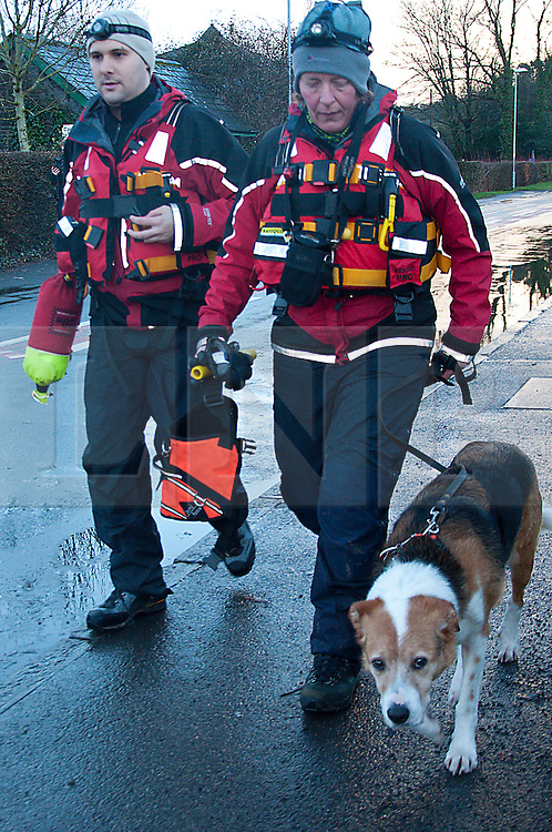 © Licensed to London News Pictures. 09/02/2014. Llangynidr,Wales, UK. Search and Rescue dog and handlers set off from the operation centre at the village hall Llangynidr. A canoeist went missing today around midday on the River Usk. Photo credit : Graham M. Lawrence/LNP