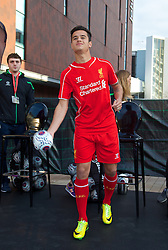 LIVERPOOL, ENGLAND - Thursday, April 10, 2014: Liverpool's Philippe Coutinho Correia throws a signed ball into the crowd at the launch of the new Warrior home kit for 2014/2015 at the Liverpool One shopping centre. (Pic by David Rawcliffe/Propaganda)
