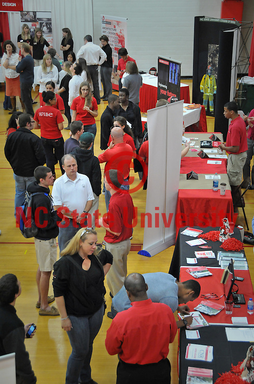 Prospective students and their families visit booths during the general information session in Carmichael Gymnasium.