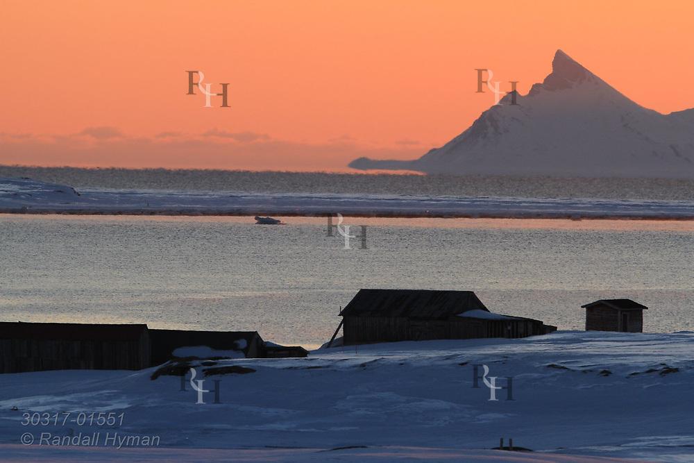 Midnight sunset at the international science village of Ny-Alesund on Spitsbergen island in Kongsfjorden; Svalbard, Norway.