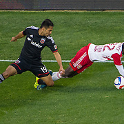 Nov 8, 2015; Harrison, NJ, USA; New York Red Bulls defender Kemar Lawrence (92) tripped by D.C. United forward Jairo Arrieta (19) during the second half of the MLS Playoffs at Red Bull Arena. Mandatory Credit: William Hauser-USA TODAY Sports