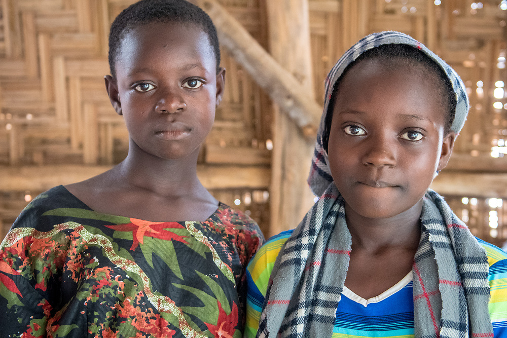 Two girls pose for the camera  in Ganta, Liberia