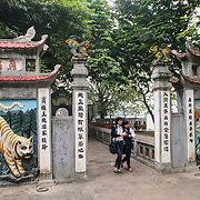 Ornately decorated gates at Ngoc Son Temple on Hoan Kiem Lake in the heart of Hanoi's Old Quarter.