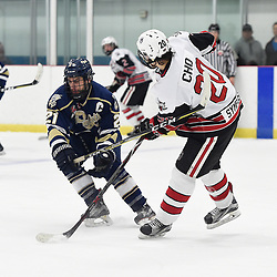 GEORGETOWN, ON  - APR 8,  2018: Ontario Junior Hockey League, South West Conference Championship Series. Game six of the best of seven series between Toronto Patriots and the Georgetown Raiders. Andrew Petrucci #21 of the Toronto Patriots battles for position with Austin Cho #20 of the Georgetown Raiders during the third period. <br /> (Photo by Andy Corneau / OJHL Images)