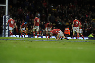 Gethin Jenkins of Wales © sinks to his knees as Australia score their match winning try in the final seconds. Dove Men, autumn international test, Wales v Australia at the Millennium Stadium in Cardiff on Sat 1st Dec 2012. pic by Andrew Orchard, Andrew Orchard sports photography,