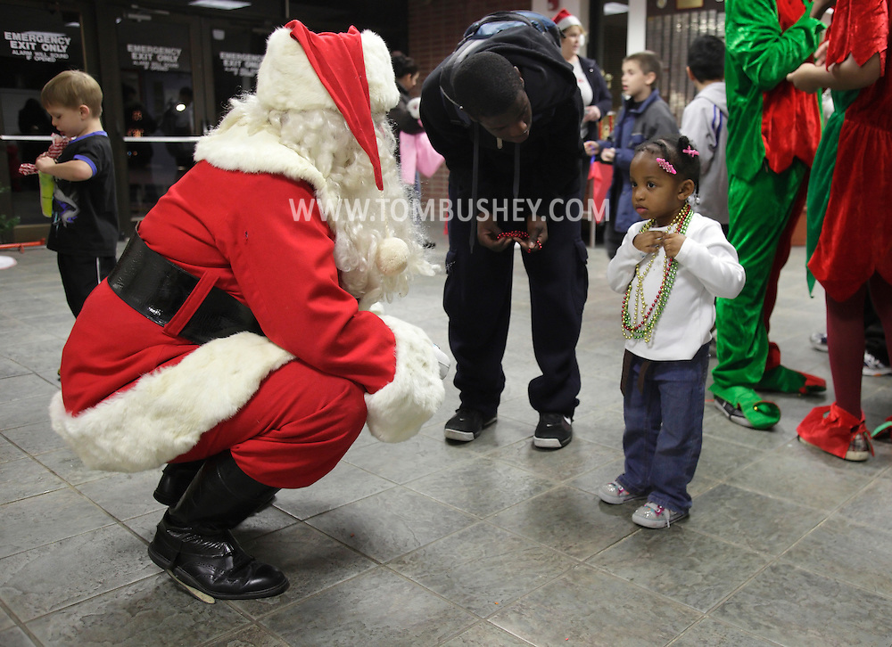 Middletown, New York - A young girl talks to Santa at the Middletown YMCA on Dec. 4, 2010.