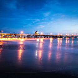 San Clemente California pier at sunset. San Clemente is a popular coastal city in Orange County in Southern California in the United States of America. Copyright ⓒ 2017 Paul Velgos with all rights reserved.