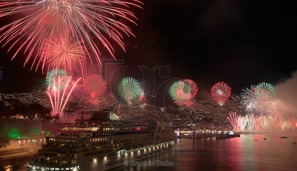 Fireworks light up the sky above Funchal Bay, Madeira Island, to celebrate the arrival of the New Year on January 1.<br />