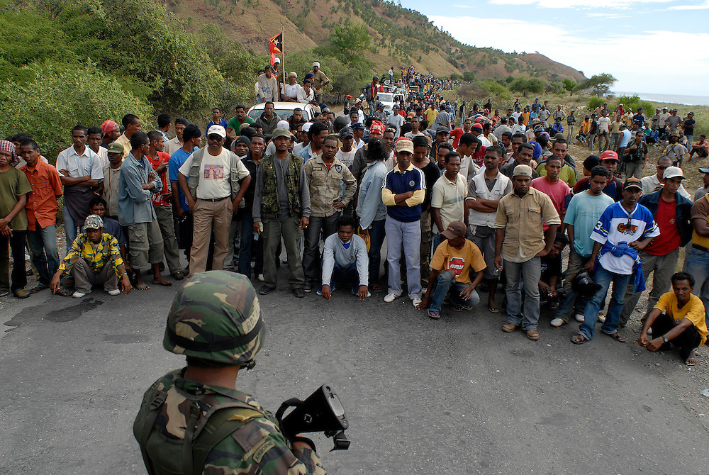 Some 2,000 protesters are stopped briefly at a military roadblock as they head for Dili to show their suipport for Xanana Gusmao, and demand the removal of Prime Minister Mari Alkatiri. East Timor 060606