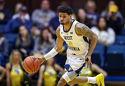 Dec 22, 2018; Morgantown, WV, USA; West Virginia Mountaineers guard James Bolden (3) dribbles the ball up the floor during the second half against the Jacksonville State Gamecocks at WVU Coliseum. Mandatory Credit: Ben Queen-USA TODAY Sports