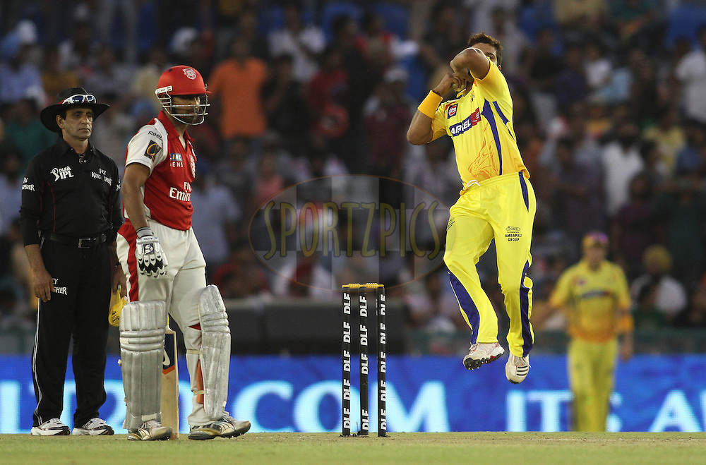 Suresh Raina of the Chennai Super Kings sends down a delivery during match 9 of the Indian Premier League ( IPL ) Season 4 between the Kings XI Punjab and the Chennai Super Kings held at the PCA stadium in Mohali, Chandigarh, India on the 13th April 2011..Photo by Shaun Roy/BCCI/SPORTZPICS