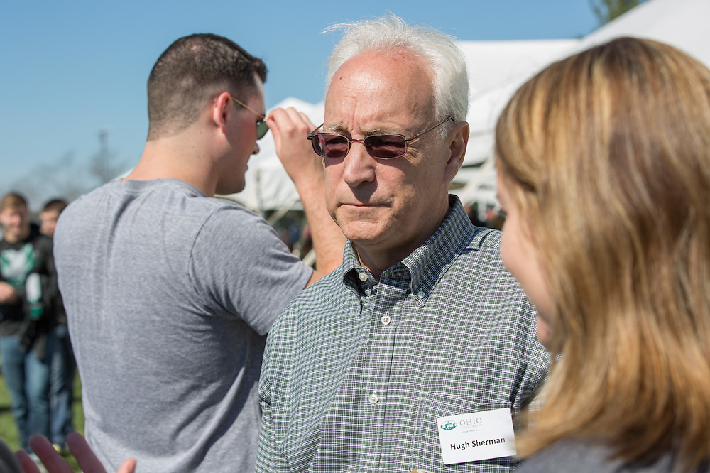 Hugh Sherman, the Dean of Ohio University's College of Business, talks with alumni from the College of Business during the college's homecoming tailgating event on October 10, 2015 at Ohio University's Tailgreat Park. Photo by Emily Matthews