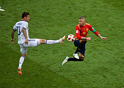 MOSCOW, RUSSIA - Sunday, July 1, 2018: Russia's Fedor Smolov and Spain's Sergio Ramos during the FIFA World Cup Russia 2018 Round of 16 match between Spain and Russia at the Luzhniki Stadium. (Pic by David Rawcliffe/Propaganda)