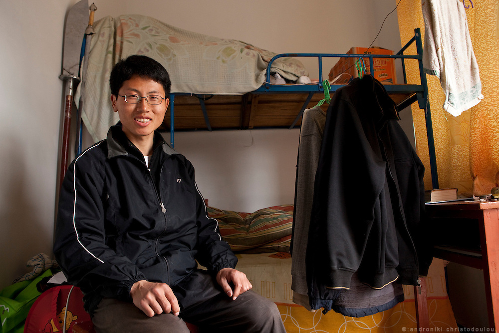 Wan Jian Yu (27) in his room. He has been living and studying at the Chenjiagou School of Taijiquan for 4 months already and he wants to stay for at least a year. He has done many jobs with his latest being a designer for advertising but he wants to become a Taijiquan teacher.