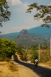 The Popa Taungkalat monastery sits atop a volcanic plug embedded in  Mt Popa, Burma (Myanmar).