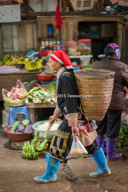 A hilltribe woman vendor leaves the markets of Sapa, Vietnam.
