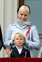 Prince Sverre Magnus and Crown Princess Mette-Marit of Norway,  Princess Ingrid Alexandra watch the annual Norwegian National Day parade from the balcony of The Royal Palace in Oslo, Norway. May 17, 2013. Photo by: Schneider-Press / i-Images. UK & USA ONLY